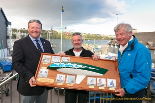 Friday 18th August 2017, Kinsale, Co. Cork Paul Wayte, skipper of Headhunter receives the Half Ton True Spirit trophy from Thomas Roche, Commodore of Kinsale YC and Philippe Pilate, President of the Half Ton Class at the prize-giving for the Euro Car Parks Half Ton Classics Cup 2017 at Kinsale Yacht Club, Ireland. Photograph: David Branigan/Oceansport